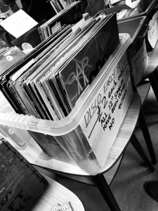 Box of records on a stall table