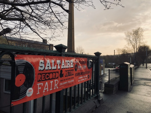 Photo of Record Fair Banner with Salts Mill in the Background